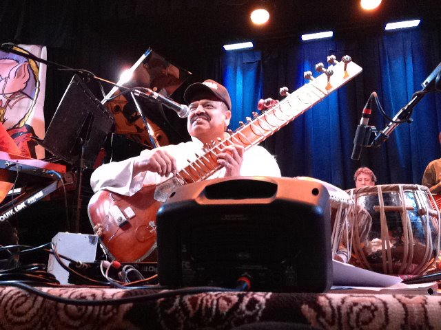 Ashwin Batish tuning his Sitar - live at the Kuumbwa Jazz Center, Santa Cruz. All rights reserved. �2012 Ashwin Batish. Copyrighted image. Photographer Chris Bratt